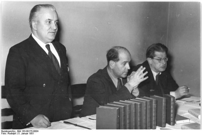 Book series of progressive writers appear. The first ten volumes of the library of advanced writers, published after the Cultural Regulation of the GDR of 16 March 1950, now appear. On this occasion, a press conference was held on 5 January 51 in Kulturbundhaus in Berlin. Shown here: Willi Bredel (left) next to Prof. Wieland Herzfelde. In the foreground, the series of books bound in leather. Right: W. Langrock, head of the Department of the Polygraphic Industry in the GDR.