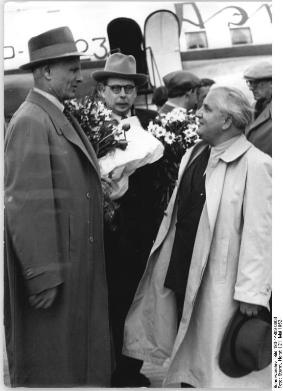 At the Schoenefeld airport, 21 May 1952 more guests arrive to participate in the 3rd German Writers' Congress. Shown here: Winner of the National Prize, Willi Bredel welcomes the Soviet poet Stepan Stschipatschew (left) and Professor Myasnikov.