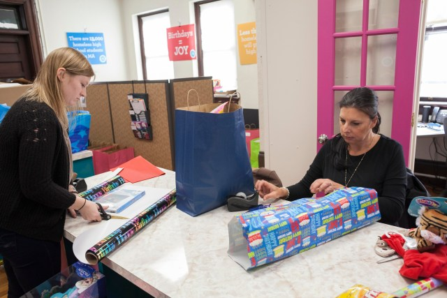 Birthday Wishes' intern Heather Coen (left) and Gail Bellefontaine, Party Coordinator for Northern Massachusetts, assemble and wrap gifts for upcoming parties at the NGO's main office in Newton, Massachusetts on Wednesday November 18, 2015. Birthday Wishes is a NGO that organizes birthday parties for homeless children in Massachusetts, Rhode Island and Long Island, New York.