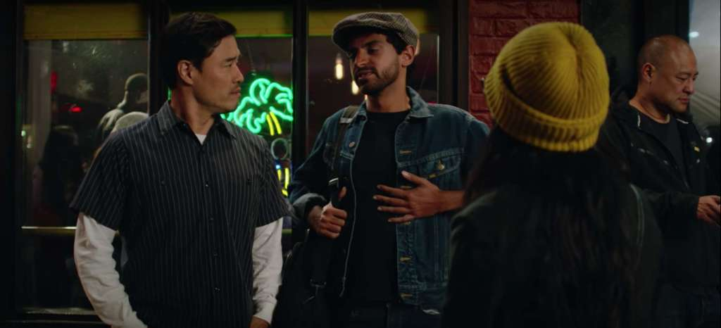 """Outside the Hello Peril show, Randall talks with bandmate played by Karan Son. But hip-hop heads will recognize the musician at far right: legendary producer Dan """"the Automator"""" Nakamura. A few more Bay Area hip-hop Easter eggs are explored here. Image: Netflix."""