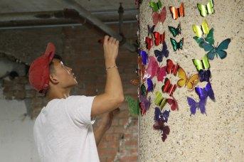 Volunteers-hang-butterflies