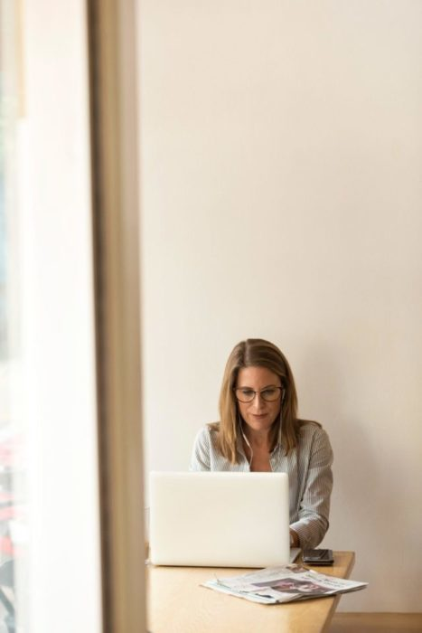 woman using her computer to review her financials