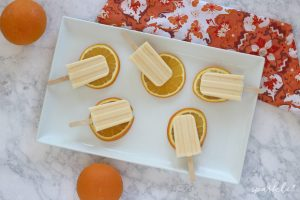 The most delicious homemade orange creamsicle ice pops out there. Made with fresh squeezed orange juice, springtime doesn't get much tastier!