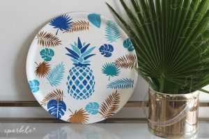 Turn a thrifted serving tray into a tropical stunner with vinyl stencils and gorgeous colored paint.