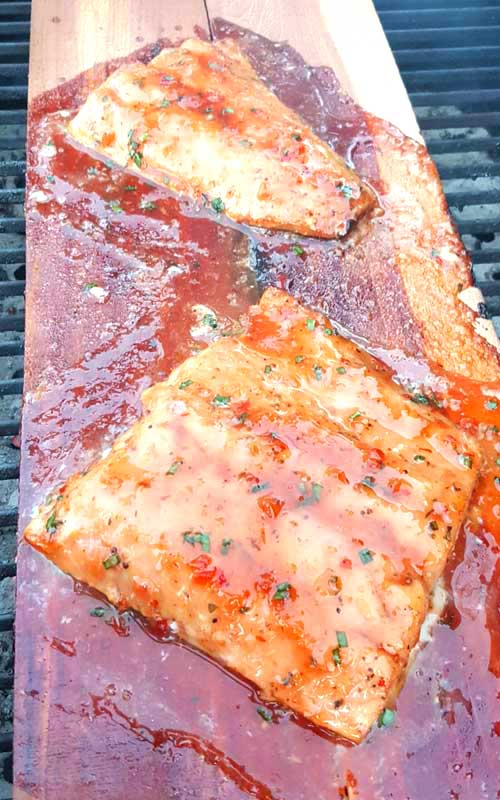 Grilled Salmon with Sweet Chili Glaze - Sweet and spicy. Light and savory. This Grilled Salmon with Sweet Chili Glaze is a perfect example of mixing flavors together, and having them work together perfectly.