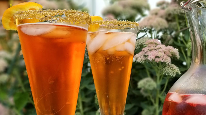 Deliciously simple Hocus Pocus Aperol Fizz with no food coloring only 3 ingredients make this beautiful drink and a little gold sugar is all you need!