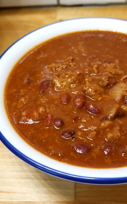 "We are pretty passionate about our Chili around here, and this my friends is my contribution to the Chili world; enter my ""Chili Lovers Chili""! It will warm your bones on a cold day, it's rich, meaty, a little bit spicy, and oh so delicious!"