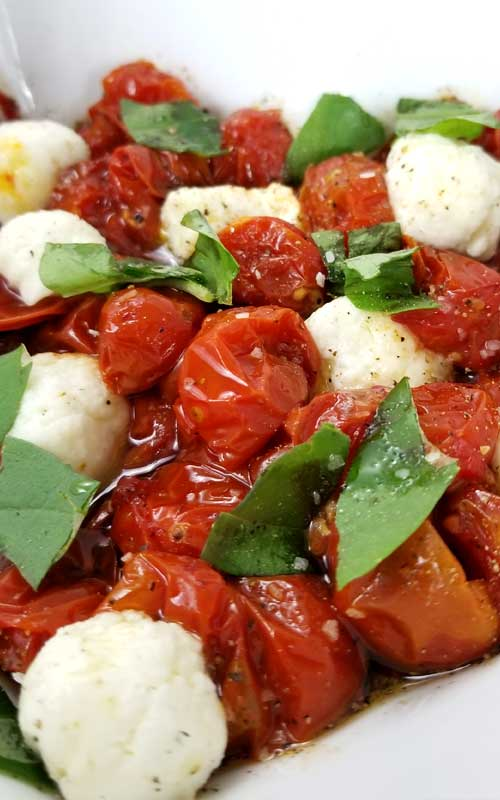 Roasted Tomato Caprese Salad Recipe - A truly delicious little salad to go with just about anything, something a little different. It only looks like you splurged, when in reality it couldn't be more budget friendly, or easy.