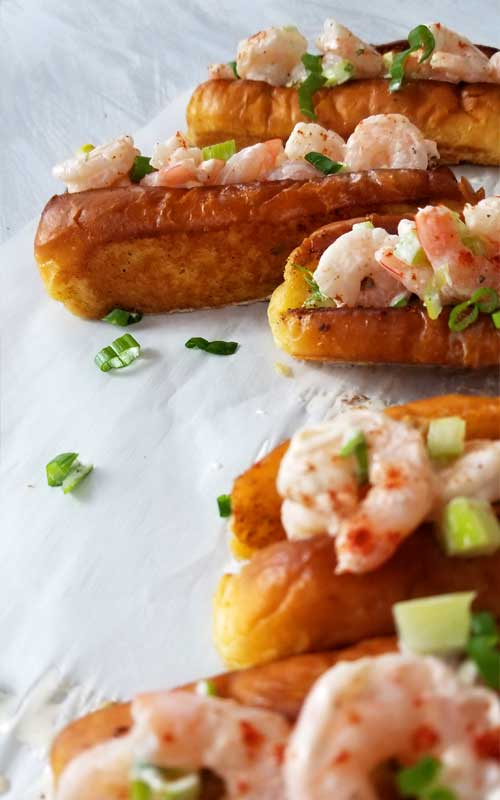 Sweet shrimp slathered in a lemon dill mayo sauce, all jammed into a potato roll. It's like taking your taste buds on a trip to a New England beach, all without leaving town.