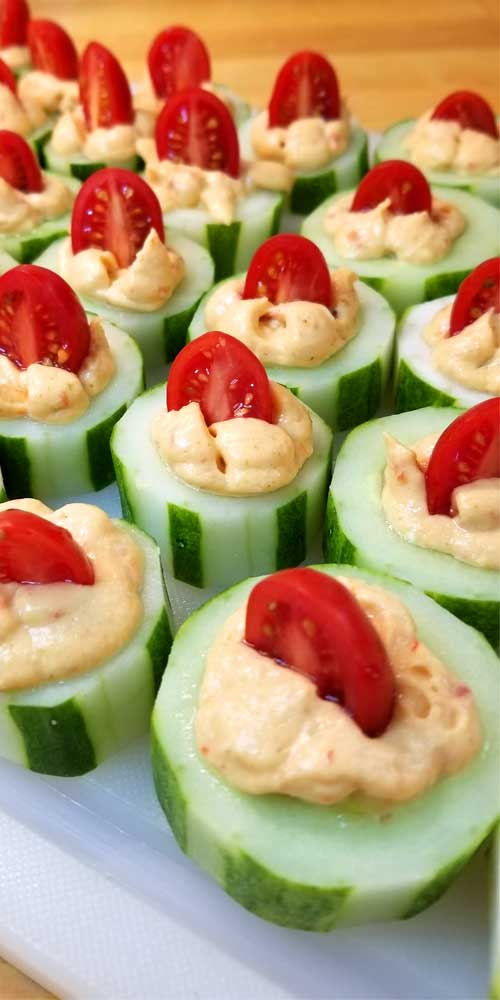 The perfect fresh and flavorful appetizer. These Cucumber Tomato Appetizer Bites are filled with a zesty roasted red pepper hummus, making for a quick and easy dish when entertaining or just a healthy snack.