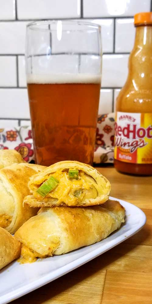 If your a fan of Buffalo Chicken, your going to fall in love with these little Beer Cheese Buffalo Bites wrapped in warm buttery crescent rolls perfect for football munching or TV binging.