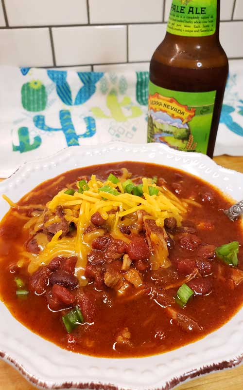 Sweet meets heat in this hearty Kansas City Style Pulled Pork Chili. Be sure to grab a cold brewsky because one's going in the pot to add to the complex flavors of this Midwestern favorite!