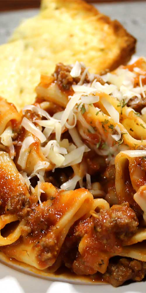 This homemade Italian Pasta and Marinara Meat Sauce will make you feel like you're pulling up a chair with generations of the great little old Italian ladies.