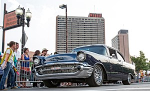 John Byrne/Tribune file photo -  A classic Chevrolet car passes by spectators in Victorian Square during a Hot August Nights Sparks Cruise last year. The 30th annual event kicks off Saturday and runs through Aug. 7.