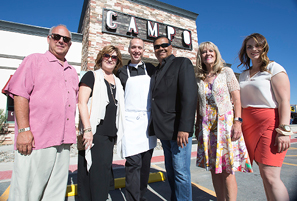 John Byrne/Tribune -  Campo Owner Sanjay Lillaney (fourth from left) and Executive Chef David Holman (third from left) join city officials at the Campo grand opening event last Thursday.