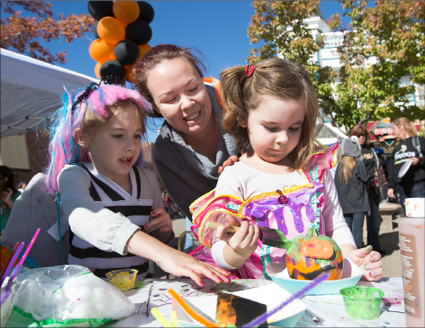 John Byrne/Tribune file photo - Young attendees of the 2015 PumpkinPalooza event take part in pumpkin painting at the annual October Victorian Square event. The 2016 version will take place this Saturday with plenty of activities for the kids.