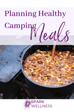 Pot of chili with corn and beans in a cast iron pot being stirred by a wooden spoon Text: Planning Healthy Camping Meals
