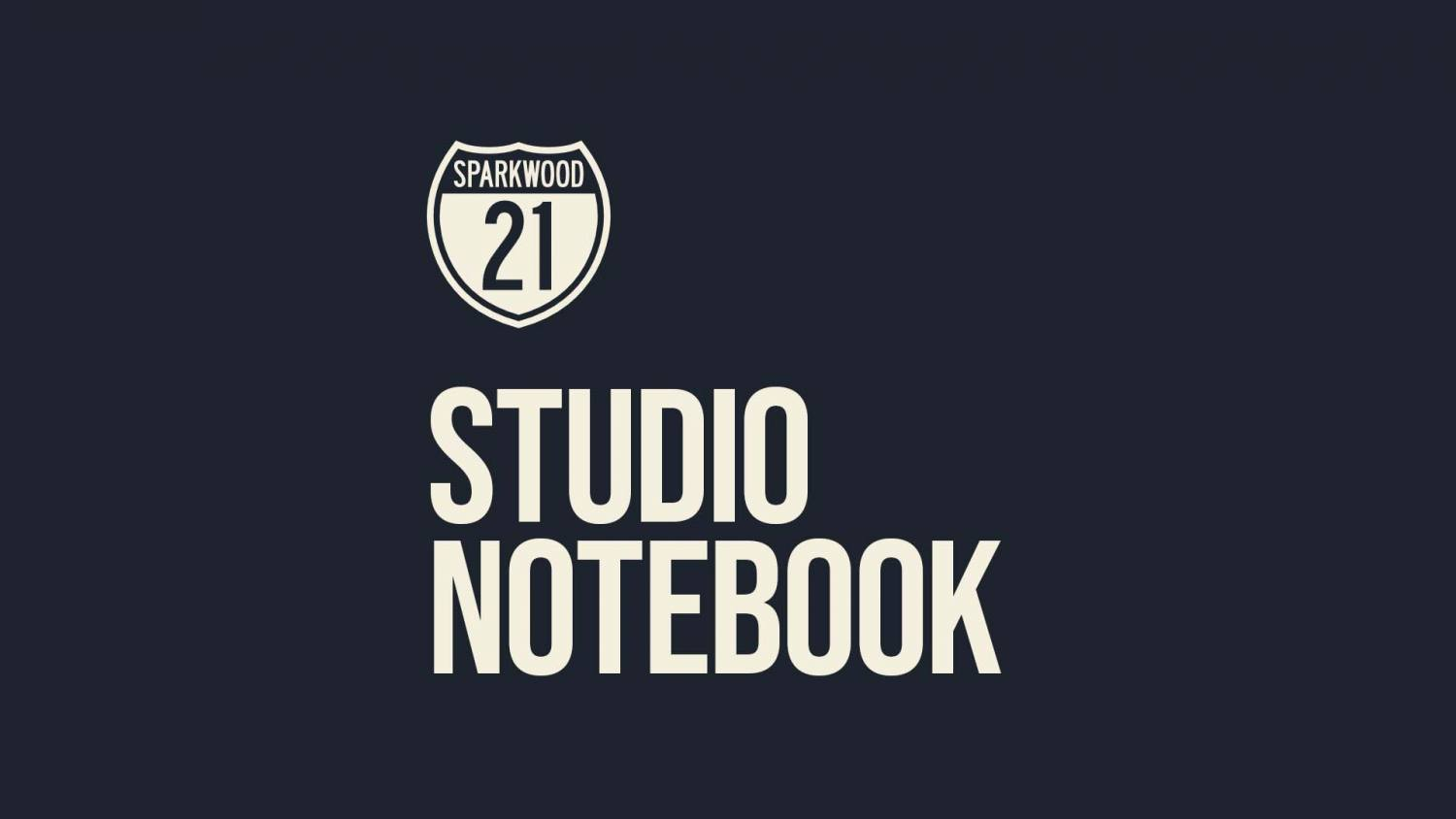 The Sparkwood and 21 Shield logo with the words STUDIO NOTEBOOK underneath