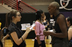 SJI student Andrea Charcas interviews Charde Houston (By Bryce Patterson)