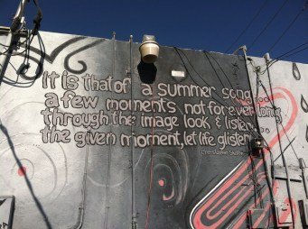 Billie Holiday lyric on the wall of Revolver records. Painted by Roy Sproule