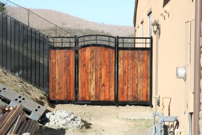 Steel gate with wood inserts
