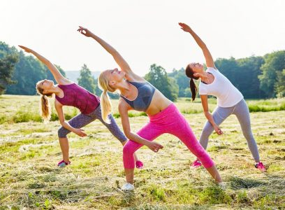 Young women doing yoga at a park in Bulgaria during the summer