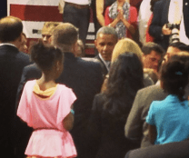 Obama shaking hands after his speech.