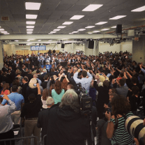 What is looked like after Obama finished his speech at Applied Materials and was down on the ground shaking hands.