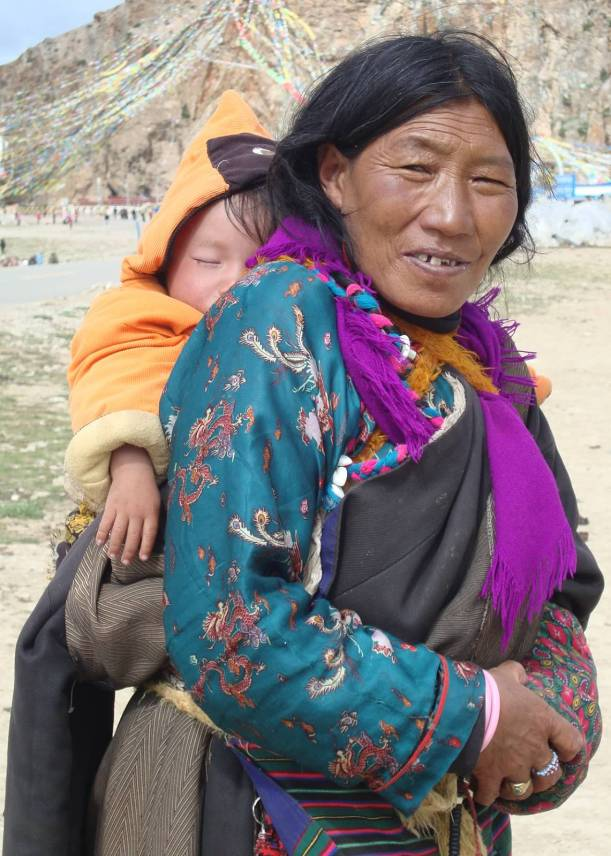 A Tibetan woman with her child