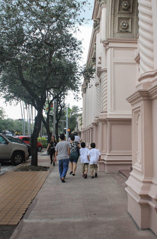 Photo of a family enjoying a walk through the streets.