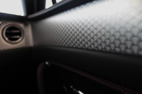 The light hits the detailing on the inside of the car that resembles scales on a fish.
