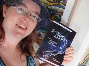Grace with a copy of Te Korero Ahi Ka