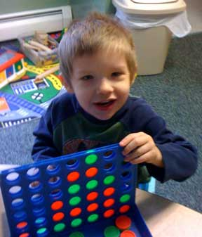 Ethan  works in developmental therapy on fine and gross motor skills.