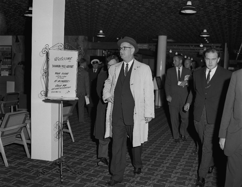 Black-and-white image of Lyndon B. Johnson leaving Shannon Ariport