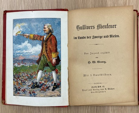 opened book with a coloured illustration of Gulliver