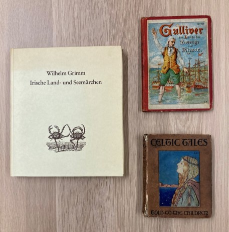 Three children's books with illustrations on their front covers
