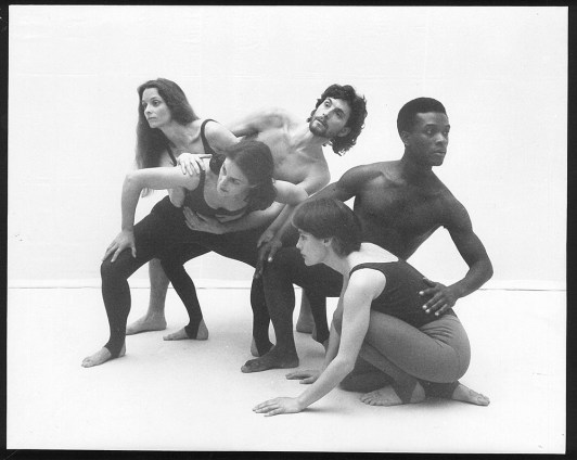 black-and-white picture of five dancers of the Dublin Contemporary Dance Theatre mid-dance, two men and three women