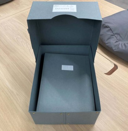 Archival folders are labelled and placed in acid-free archival boxes