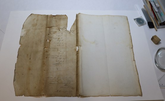 Torn archival document in need of conservation