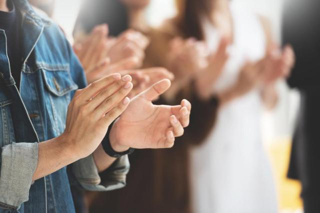 Cropped image of Creative designers audience applauding at a business seminar.
