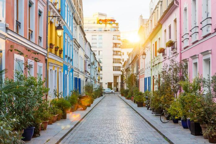 Rue Crémieux multicolored street during sunrise without people in Paris, France
