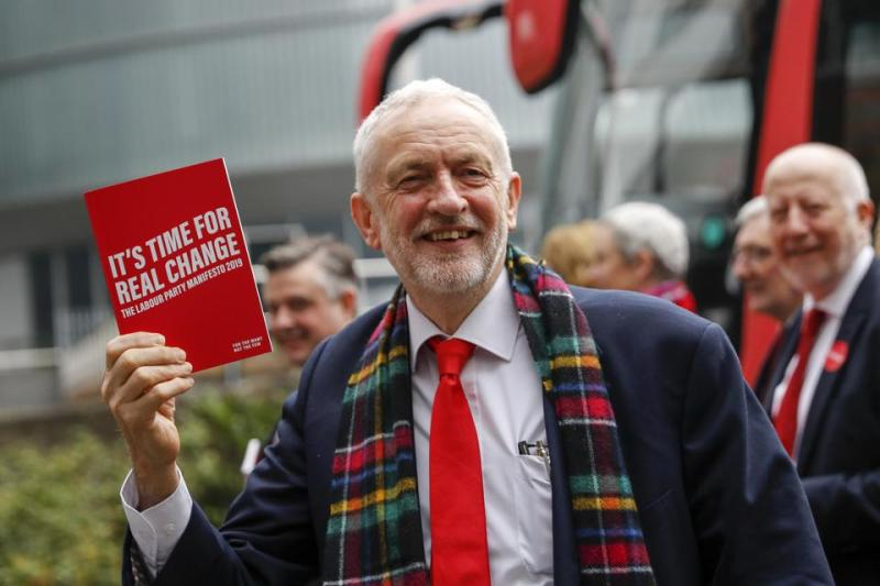 Jeremy Corbyn, leader of the Labour party, holds a copy the party's 2019 manifesto.
