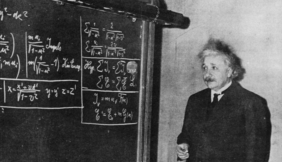 Einstein deriving special relativity, for an audience of onlookers, in 1934.