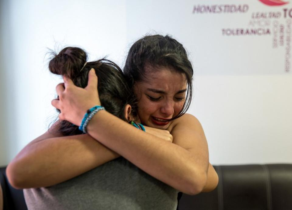Central American girls say a tearful goodbye before being deported from a shelter for unaccompanied migrant children and teens in Reynosa, Mexico.
