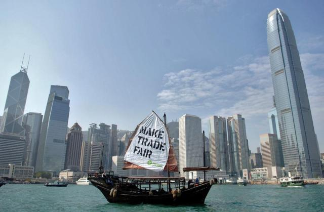 Oxfam members boards to protest against World Trade Organization's meeting in Hong Kong harbor in China in Thursday, December 1, 2005.PHoto by Seokyong Lee/Bloomberg News