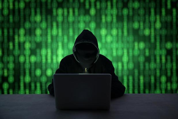 Blockchain: Hacker With Obscured Face Utilizing Laptop At Desk