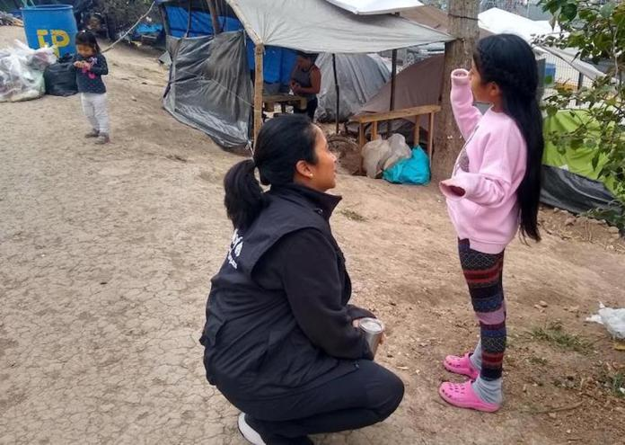 On January 29, 2020, UNICEF Mexico Deputy Representative Pressia Arifin-Cabo speaks with a child in an encampment in Matamoros in the northeastern state of Tamaulipas.