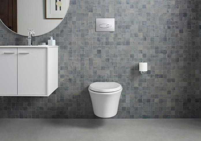 This wall-thing shower-toilet by Kohler shows the honed white actuator plate.