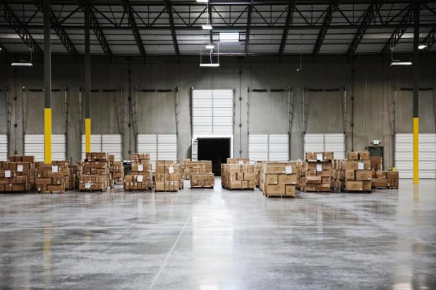 Blockchain: Cardboard boxes at loading dock in warehouse