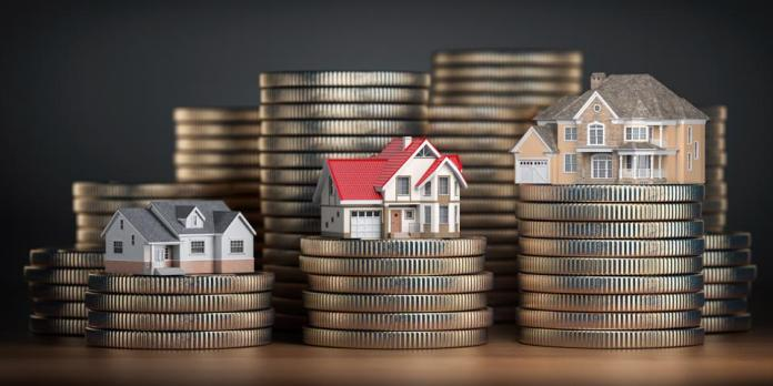Houses of different size with different value on stacks of coins.